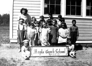 Dorothy Alksne permit teacher with her class 1945-46 courtesy of Dorothy Karklin.