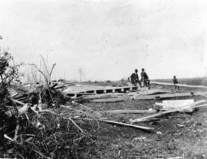 After the cyclone in Landerville W. D. Halliday and son Earl along with Dr. Malcolm surveying the damage.